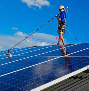 Professional Solar Panel Cleaning with pure water fed pole and safety harness