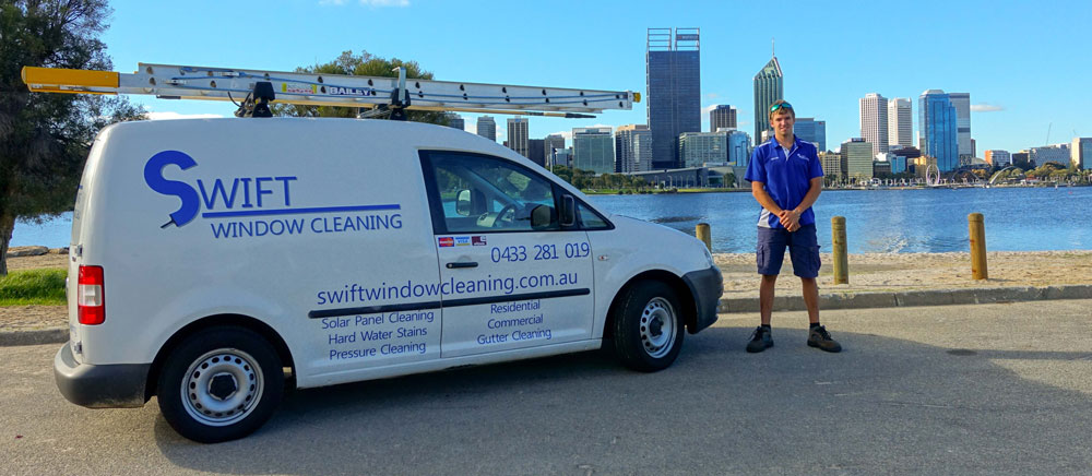 Swift window cleaning company van infront of Perth city with business owner standing near van