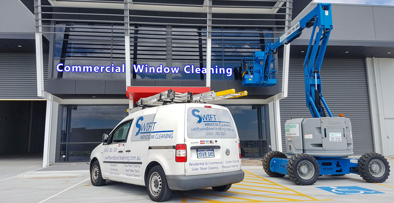Swift window cleaning van and elevated work platform in front of commercial building in Canning Vale