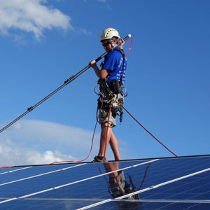 Solar panel cleaning safely in harness